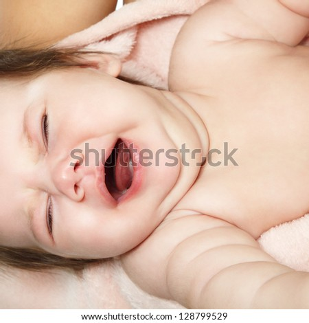 crying baby infant, kid's face closeup - stock photo
