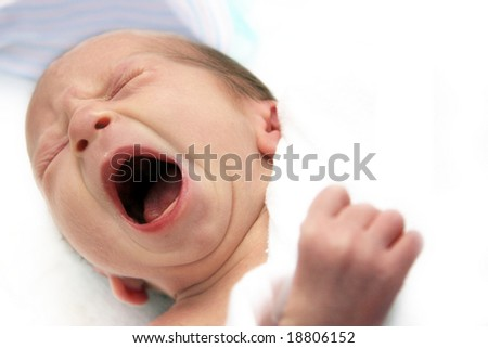 Crying baby on his first day - stock photo