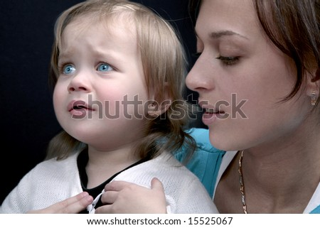 Crying baby with mother, isolated - stock photo