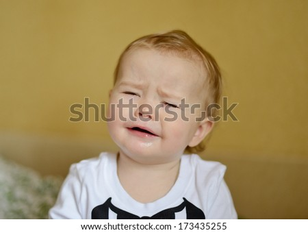 crying baby with sad face - stock photo