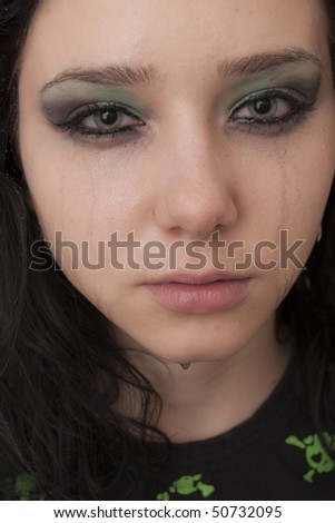 Crying Beautiful Brunette Rocker Girl - stock photo