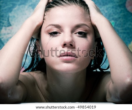 Crying beauty  woman in bath with tears on face - stock photo