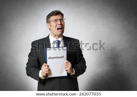 Crying business man with german dismissal - stock photo