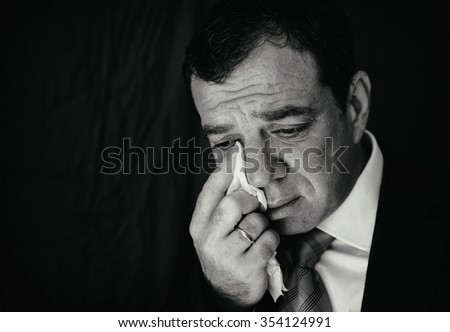 Crying businessman - stock photo