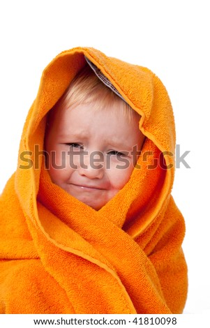 crying child after bath with orange towel