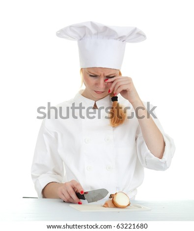 crying female cook in white uniform cutting onion - stock photo