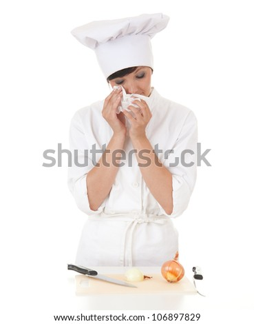 crying female cook in white uniform cutting onion, white background