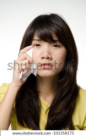 Crying girl wearing yellow shirt - stock photo