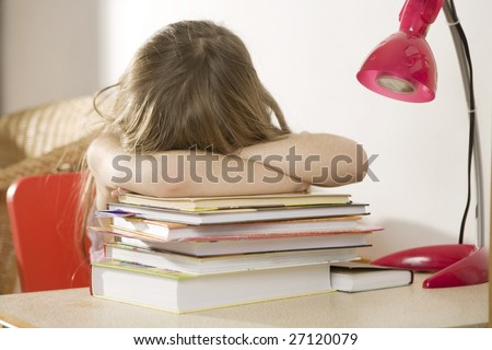Crying  little girl studying at the desk - stock photo