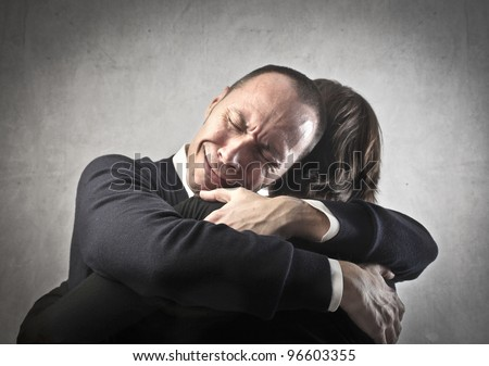 Crying man hugging his wife