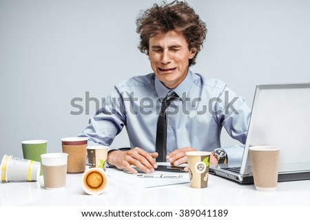 Crying man. Negative emotion facial expression feeling. Modern office man at working place, depression and crisis concept - stock photo