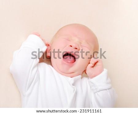 Crying newborn baby boy - stock photo