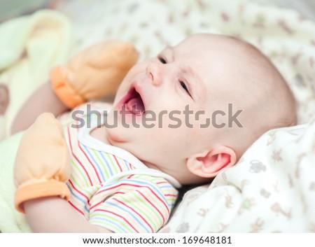 Crying newborn baby closeup - stock photo