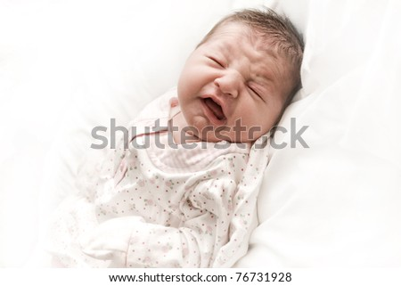 Crying newborn infant with closed eyes. - stock photo