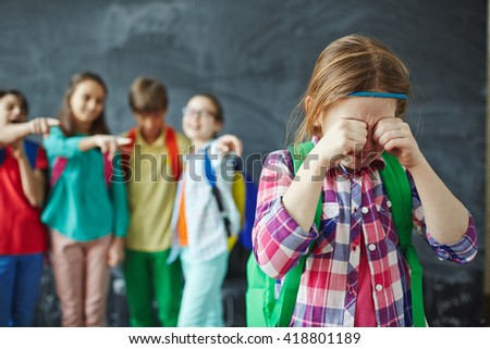 Crying schoolgirl - stock photo