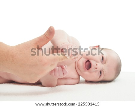 Crying small caucasian baby boy hold woman finger isolated - stock photo