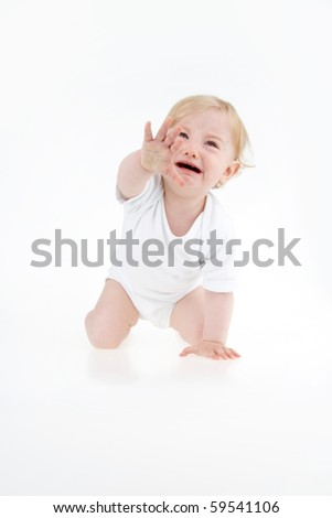 Crying suckling crawler on all fours on white background.