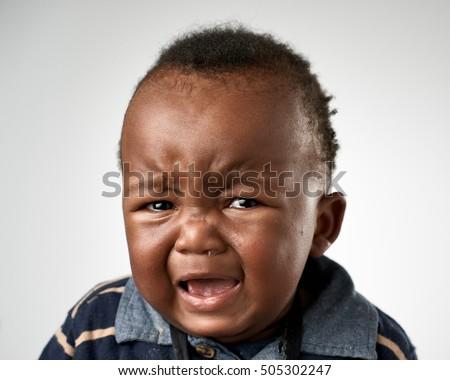 crying upset black african baby boy stock photo 505302247