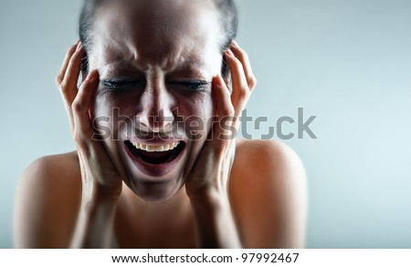 Crying woman on a light background