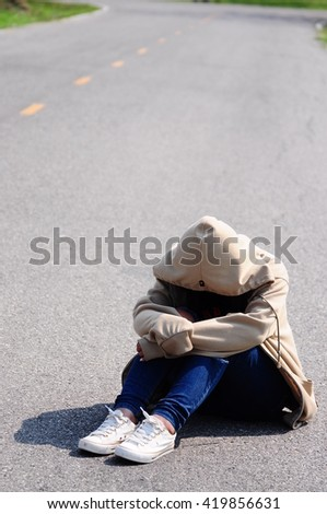 Crying woman on the road