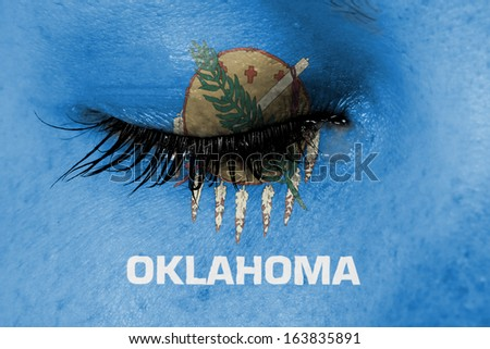 Crying woman, pain and grief concept, flag of Oklahoma - stock photo