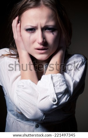 Crying young girl isolated - stock photo