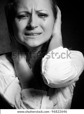 Crying young girl isolated , monochrome photo - stock photo