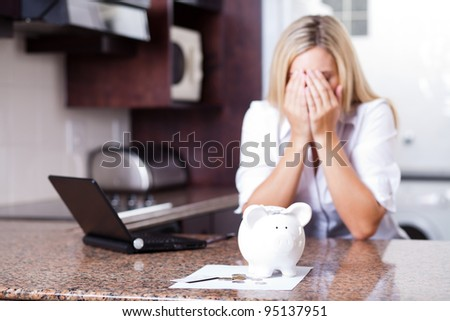 crying young woman having financial problems
