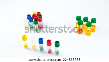 Cryo tubes with cryoperles for microbiological culture preservation and reagents used in identification of mycoplasma and ureaplasma bacteria. Laboratory medicine concept - stock photo