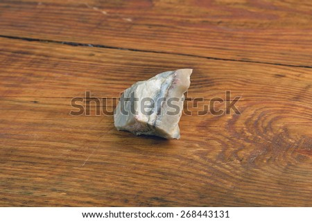 crystal agate on the wooden table - stock photo