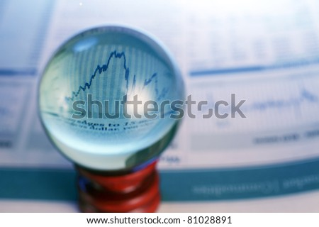 crystal ball on the newspaper - stock photo
