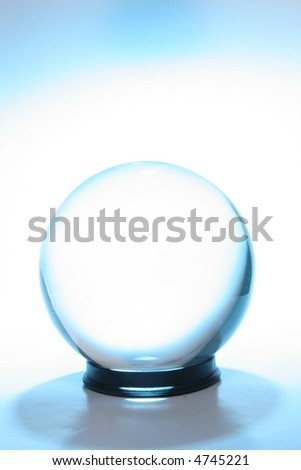 Crystal ball surrounded by blue light