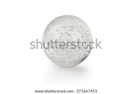 Crystal ball with bubbles and reflection isolated on white