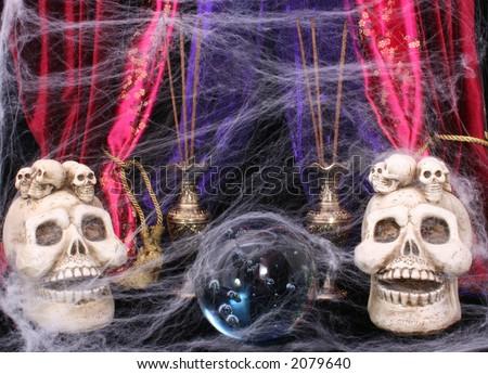 Crystal Ball with Skulls and Cobwebs - stock photo