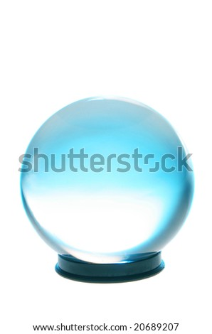 Crystal ball with turquoise and white light inside - stock photo