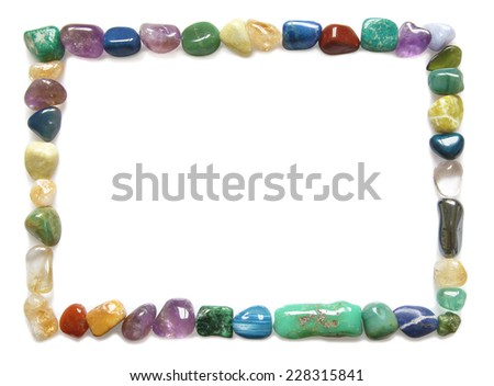 Crystal Border  -  A full rectangle comprised of multicolored tumbled stones on a white background - stock photo