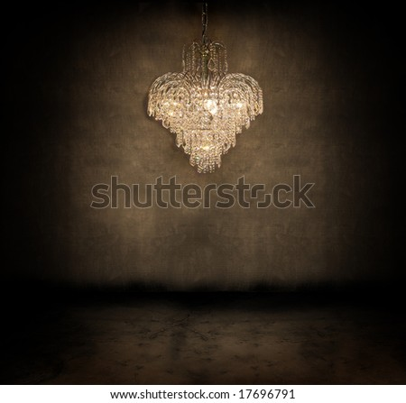 Crystal chandelier hanging in a dark grungy room - stock photo