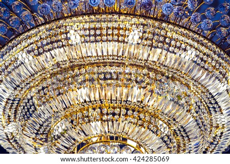 Crystal Chandelier in Ballroom sparkling and shinny during Party, contrast - stock photo