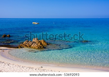 Crystal clean sea along white sand beach - stock photo