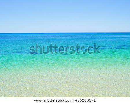 Crystal clear blue ocean water background - stock photo