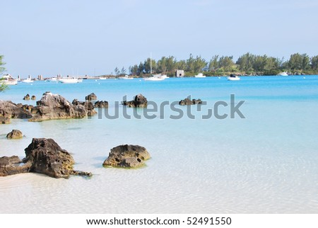 Crystal clear blue water beach with calm sea - stock photo