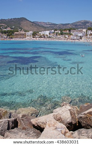 Crystal clear blue water seen at the Peguera beach on a sunny day which is a popular tourist area on the island of Mallorca