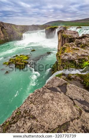 Crystal clear Godafoss waterfall - stock photo