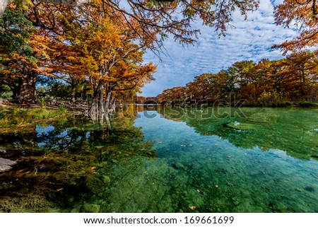 Crystal Clear Green Waters of the Frio River Surrounded by Beautiful Fall Foliage at Garner State Park, Texas. - stock photo
