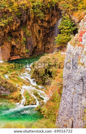 Crystal clear mountain stream in autumn scenery of Plitvice Lakes in Croatia
