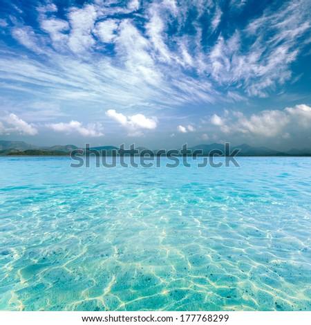 Crystal clear sea of tropical island - stock photo