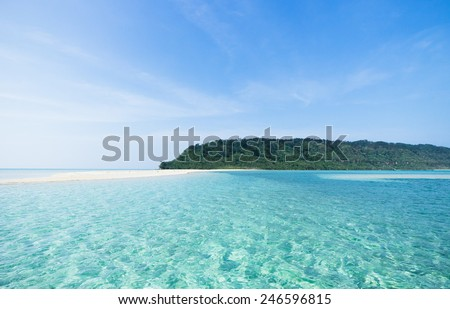 Crystal clear tropical water and a deserted tropical island of southern Japan, Okinawa - stock photo