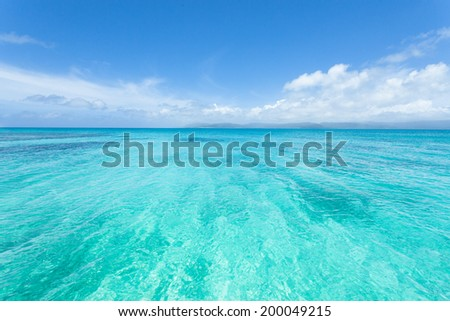Crystal clear tropical water and blue sky, Okinawa, Japan - stock photo