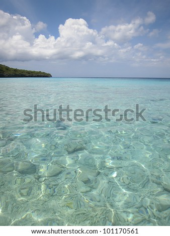 Crystal clear, turquoise waters and white sandy beach of caribbean sea in Curacao - stock photo