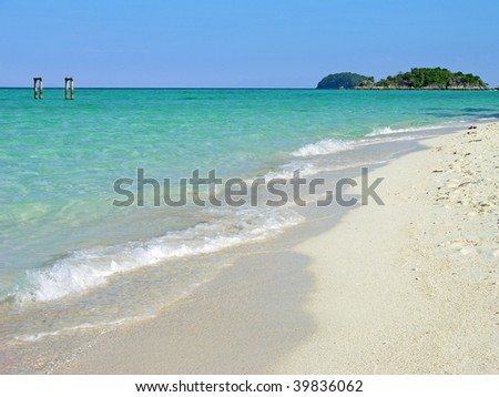 Crystal clear water and white sand on the tropical island in Andaman sea. Thailand